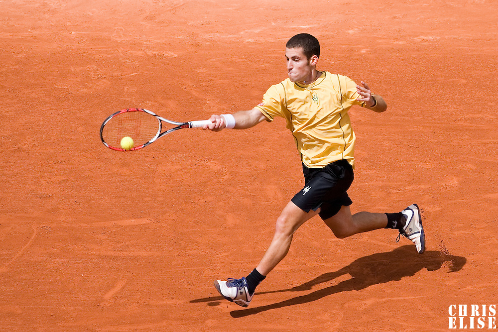 31 May 2007: Flavio Cipolla of Italy returns a shot to Rafael Nadal of Spain during the Men's Singles 2nd round match on day five of the French Open at Roland Garros in Paris, France.