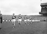 Kerry Team parades out onto the pitch before the start of the All Ireland Senior Gaelic Football Final Kerry v Down in Croke Park on the 22nd September 1960. Down 2-10 Kerry 0-8.