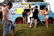 BETHLEHEM, PA – MAY 30, 2011: On Memorial Day, 2011, families wait for ice cream from Gerry Torres, a Puerto Rican immigrant who has served ice cream out of a truck he has owned for eight years. Saucon Park has become a well established hang out spot for the rapidly increasing Hispanic population in the Pennsylvania's Lehigh Valley.<br /> <br /> As the population of second and third generation Hispanics increases dramatically in the United States, a new boldness can be sensed among Latinos in America, stretching far beyond the southern border states. Demographers in Pennsylvania say the towns of Bethlehem, Allentown and Reading are set to become majority-minority cities, where Hispanics comprise a bigger portion of the population than whites. As this minority population increases dramatically in the region, Latinos are inching closer to their own realization of the American Dream, while gradually shifting the physical and cultural landscapes of their communities.