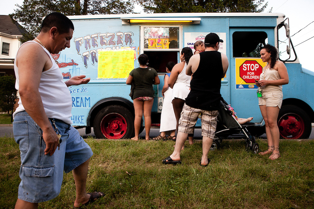 BETHLEHEM, PA – MAY 30, 2011: On Memorial Day, 2011, families wait for ice cream from Gerry Torres, a Puerto Rican immigrant who has served ice cream out of a truck he has owned for eight years. Saucon Park has become a well established hang out spot for the rapidly increasing Hispanic population in the Pennsylvania's Lehigh Valley.<br />