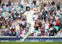 England's Joe Root celebrates his century during the test match at The Kia Oval, London.