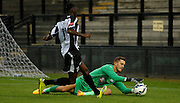 New signing Kleton Perntreou making the diving save during the Pre-Season Friendly match between Tooting & Mitcham and Crystal Palace at Imperial Fields, Tooting, United Kingdom on 24 July 2015. Photo by Michael Hulf.