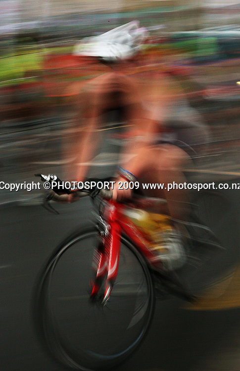 A competitor mounts her bike during theContact Trophy women's race.<br /> Contact Tri-Series National Triathlon Championships and ITU Oceania Cup at Wellington Waterfront, Wellington , New Zealand. Saturday 7 March 2009. Photo: Dave Lintott/PHOTOSPORT