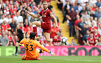 Football - 2017 / 2018 Premier League - Liverpool vs. Arsenal<br /> <br /> Jordan Henderson of Liverpool knocks a shot past Petr Cech of Arsenal at Anfield.<br /> <br /> COLORSPORT/LYNNE CAMERON