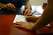 Israel, female patient signs a medical release form before breast implant surgery