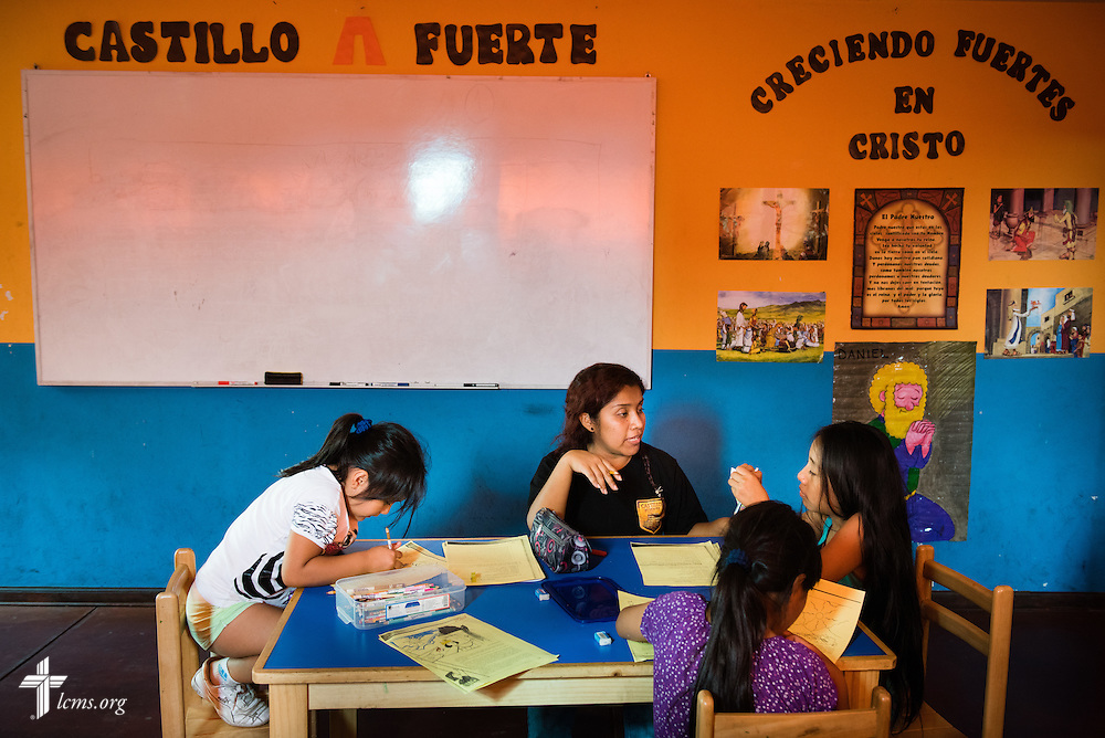 A teacher and children work on an activity together following school at Castillo Fuerte on Wednesday, April 8, 2015, in La Victoria, Peru. LCMS Communications/Erik M. Lunsford