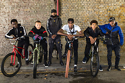 "Left to right, Trizzy, 16, Liam Ross, 17, Mac Ferrari, Pharell ""PJ"" Samuel, 16, Tevon 'TJ Jules, 13, and Daniel 16,. Bikestormz is the brainchild of leader Mac Ferrari, a group of young trick cyclists who are encouraged to put knives down and enjoy the healthy, positive side of urban youth culture by joining together  and developing their cycling skills. London, September 27 2019."