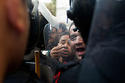 Egyptian riot police battle protesters during continuing January 26, 2011 demonstrations in downtown Cairo, Egypt. A series of unprecedented demonstrations have broken out across Egypt for the past two days, inspired by the revolution in Tunisia, and intended to spark a similar movement in Egypt. (Photo by Scott Nelson)
