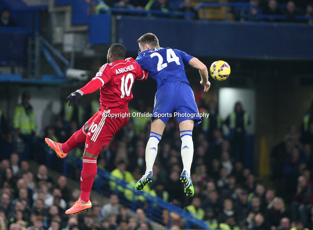 22 November 2014 - Barclays Premier League - Chelsea v West Bromwich Albion - Victor Anichebe of Albion and Gary Cahill of Chelsea collide mid air.<br /> <br /> <br /> Photo: Ryan Smyth/Offside