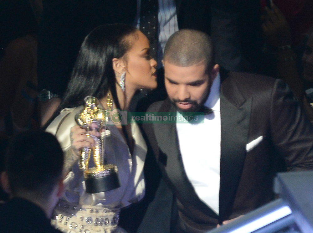 Drake presents Rihanna with the Michael Jackson Vanguard Award at the MTV Video Music Awards 2016, Madison Square Garden, New York City. Photo credit should read: Doug Peters/EMPICS Entertainment