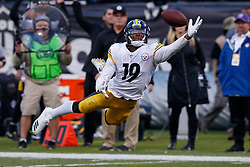 OAKLAND, CA - DECEMBER 09: Wide receiver JuJu Smith-Schuster #19 of the Pittsburgh Steelers dives for but is unable to catch a pass against the Oakland Raiders during the fourth quarter at the Oakland Coliseum on December 9, 2018 in Oakland, California. The Oakland Raiders defeated the Pittsburgh Steelers 24-21. (Photo by Jason O. Watson/Getty Images) *** Local Caption *** JuJu Smith-Schuster