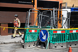 © Licensed to London News Pictures. 14/05/2019. London, UK. The scene on Great Peter Street where a fire around a building site caused damage to buildings and the surrounding area. Photo credit : Tom Nicholson/LNP