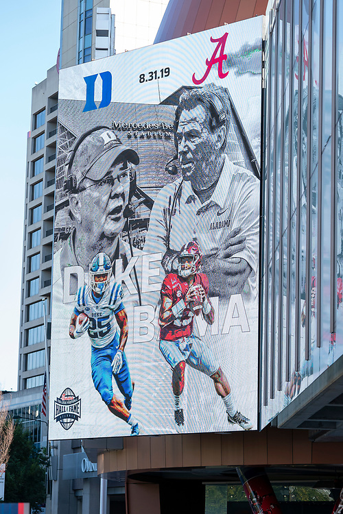 An advertisement for the 2019 Chick-fil-A Kickoff Game between Duke and Alabama appears on the video board outside the College Football Hall of Fame, Friday, August 30, 2019, in Atlanta. (Paul Abell via Abell Images for the Chick-fil-A Kickoff Game)