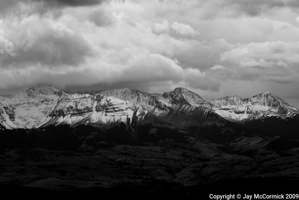 Mountains of Dallas Pass in Colorado just after early fall snow.  Storm clouds are just starting to roll out.