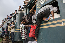 June 23, 2017 - Dhaka, Bangladesh - Bangladeshi people climb onto the roof of an overcrowded train as they travel back to their homes ahead of Eid Al-Fitr celebrations at the Gazipur Railway Station in Dhaka, Bangladesh, 23 June 2017. Millions of city dwellers travel to villages to celebrate the festival, which marks the end of the Muslim fasting month of Ramadan. (Credit Image: © Probal Rashid via ZUMA Wire)