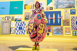 © Licensed to London News Pictures. 05/06/2018. LONDON, UK. Grayson Perry RA in one of the vividly coloured galleries at the preview of the 250th Summer Exhibition at the Royal Academy of Arts in Piccadilly, which has been co-ordinated by Grayson Perry RA this year.  Running concurrently, is The Great Spectacle, featuring highlights from the past 250 years.  Both shows run 12 June to 19 August 2018.  Photo credit: Stephen Chung/LNP