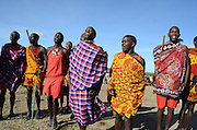 Kenya, Masai Mara, members of the Masai tribe entertain tourists