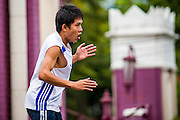 06 OCTOBER 2012 - BANGKOK, THAILAND:  An instructor leads a public exercise class in Lumphini Park in Bangkok. The Thai government promotes exercise classes as a way staying healthy. Lumphini Park is 142 acre (57.6-hectare) park in Bangkok, Thailand. This park offers rare open public space, trees and playgrounds in the congested Thai capital. It contains an artificial lake where visitors can rent boats. Exercise classes and exercise clubs meet in the park for early morning workouts and paths around the park totalling approximately 1.55 miles (2.5 km) in length are a popular area for joggers. Cycling is only permitted during the day between the times of 5am to 3pm. Smoking is banned throughout the park. The park was created in the 1920's and named after Lumbini, the birthplace of the Buddha in Nepal.   PHOTO BY JACK KURTZ