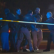 Police stop a family member from approaching the scene of a shooting on Veterans Boulevard in Brundidge, Ala., early Saturday, Dec. 27, 2014. One person was killed at the scene, and others were transported to a local hospital. (Photo/Thomas Graning)
