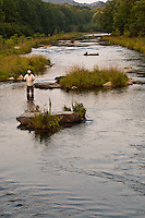 FLY ANGLER WADE FISHING IN THE MOUNTAIN FORK RIVER NEAR BROKEN BOW, OKLAHOMA