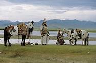 Mongolia. Mr. Baljiniam shooting Gengis Khan movie. Jenghiz Khan in military dress on the Orkhon river side  Underchirit