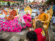 20 SEPTEMBER 2015 - SARIKA, NAKHON NAYOK, THAILAND:  Chinese Lion Dancers prostrate themselves before a Buddhist monk at the Ganesh festival at Shri Utthayan Ganesha Temple in Sarika, Nakhon Nayok. Ganesh Chaturthi, also known as Vinayaka Chaturthi, is a Hindu festival dedicated to Lord Ganesh. Ganesh is the patron of arts and sciences, the deity of intellect and wisdom -- identified by his elephant head. The holiday is celebrated for 10 days. Wat Utthaya Ganesh in Nakhon Nayok province, is a Buddhist temple that venerates Ganesh, who is popular with Thai Buddhists. The temple draws both Buddhists and Hindus and celebrates the Ganesh holiday a week ahead of most other places.   PHOTO BY JACK KURTZ
