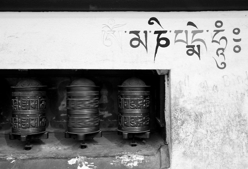 Prayer wheels and Nepali writing at the Swayambunath Stupa in Kathmandu, Nepal