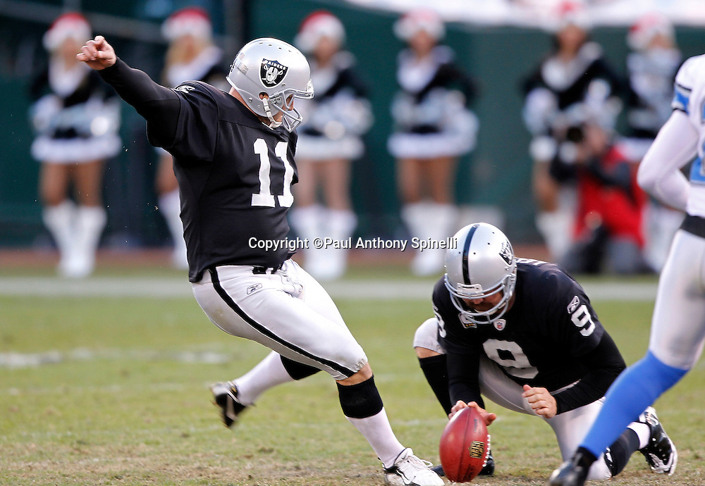 Oakland Raiders kicker Sebastian Janikowski (11) attempts a game winning field goal that gets blocked at the end of the NFL week 15 football game against the Detroit Lions on Sunday, December 18, 2011 in Oakland, California. The Lions won the game 28-27. ©Paul Anthony Spinelli