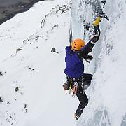 Róbert Halldórsson climbing Íste WI 4, at Múlafjall, Hvalfjörður, Iceland.
