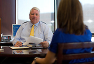 Larry Helling, President of Cedar Rapids Bank & Trust, talks with Wendy Nielsen, Assistant Vice President of Media Relations, in his office in Cedar Rapids, Iowa on Monday, August 20, 2012. .