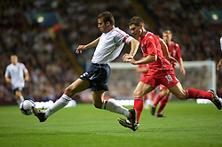 BIRMINGHAM, ENGLAND -Tuesday, October 14, 2008: Wales' Sam Vokes challenges for the ball with England's Steven Taylor during the UEFA European Under-21 Championship Play-Off 2nd Leg match at Villa Park. (Photo by Gareth Davies/Propaganda)
