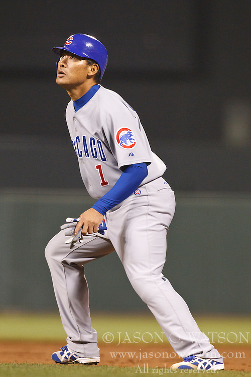 August 10, 2010; San Francisco, CA, USA;  Chicago Cubs right fielder Kosuke Fukudome (1) watches a fly ball while leading off first base during the ninth inning against the San Francisco Giants at AT&T Park.  Chicago defeated San Francisco 8-6.