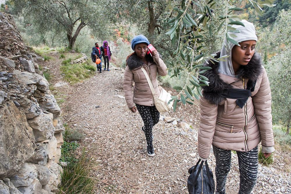 November 9, 2016 - Breil-sur-Roya, France:  Eritrean migrants who  arrived through a  tunnel by foot in the Roya valley from Italy - a 7-hour walk arrive at their temporary shelter with C&eacute;dric Herrou. <br /> <br /> 9 novembre 2016 - Breil-sur-Roya, France: Les migrants &eacute;rythr&eacute;ens qui sont arriv&eacute;s &agrave; pied par un tunnel ferroviaire dans la vall&eacute;e de la Roya depuis l'Italie - une marche de 7 heures - marchent vers leur abri temporaire chez Cedric Herrou, membre d'un r&eacute;seau qui aide des migrants.