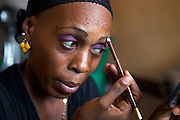 Amanda Alipha Uma putting on her makeup. Amanda is a commercial sex worker, Dar Es salaam, Tanzania...She is a member of a grass roots support group for commercial sex workers, in Dar-es-Salaam, Tanzania...This grass roots group is supported by Women's Fund Tanzania, where VSO volunteer Louise Jenkins is working as a Parliamentary Research Advisor.