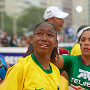 The Brazilian women's team celebrate winning the Women's Homeless Football World Cup Final defeating Mexico 7-3. Sixty-four national homeless teams took part in the International football tournament staged on Copacabana beach. Rio de Janeiro. The Brazilian men made it a clean sweep for Brazil defeating Chile 6-0 in the Men's World Cup Final. The Homeless World Cup aims at beating homelessness through football and brings awareness to the one billion people who are homeless in the world today. Rio de Janeiro,  Brazil. 26th September 2010. Photo Tim Clayton.