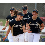 Alexis Karkoska, 9, front left,  Prena Keira, front right, and teammates celebrate their victory over CB South winning the Class AAAA softball title S at Plymouth Whitemarsh HS.. Spring-Ford beat CB South 4-2.