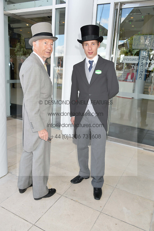 Left to right, LESTER PIGGOTT and his son JAMIE PIGGOTT at the Investec Derby 2015 at Epsom Racecourse, Epsom, Surrey on 6th June 2015.