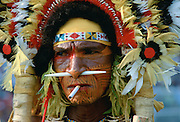 Cigarette matching a bone through the nose of a man at a Sing Sing tribal gathering in Papua New Guinea