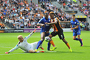 Hull City striker Abel Hernandez (9) tries for a shot at goal stopped by Leicester City's Robert Huth (6) and Leicester City's Kasper Schmeichel (1) during the Premier League match between Hull City and Leicester City at the KCOM Stadium, Kingston upon Hull, England on 13 August 2016. Photo by Ian Lyall.