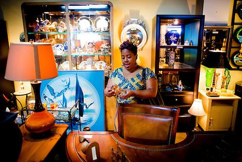 ORLANDO, FL    Kevia Rucker Of Orlando Checks Out Vintage Glasses As She  Shops.