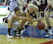 Monticello's Kelsey Iben (22) and North-Linn's Laura Moorman (13) fight for a lose ball during their Rivalry Saturday game at Washington High School at 2205 Forest Drive SE in Cedar Rapids on Saturday, January 21, 2012. (Stephen Mally/Freelance)