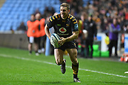 Wasps flyhalf Jimmy Gopperth (12) runs with the ball  during the Gallagher Premiership Rugby match between Wasps and Saracens at the Ricoh Arena, Coventry, England on 21 February 2020.