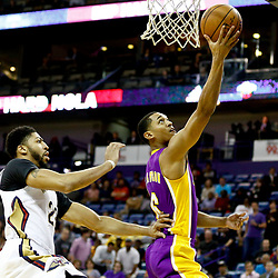 Nov 29, 2016; New Orleans, LA, USA; Los Angeles Lakers guard Jordan Clarkson (6) shoots past New Orleans Pelicans forward Anthony Davis (23) during the first quarter of a game at the Smoothie King Center. Mandatory Credit: Derick E. Hingle-USA TODAY Sports