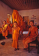 Buddhist boys in training at temple rest in dormitory room in Vientiane, Laos
