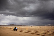 Watson Honanie and Lester Honavema plant blue corn in their sandy desert fields located eight miles southwest of Hotevilla.  The Hopi men clear, plant and harvest the fields while the Hopi women are responsible for the seeds and harvest products.