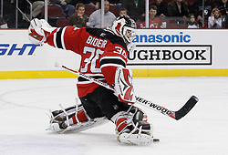 Oct 17, 2009; Newark, NJ, USA; New Jersey Devils goalie Martin Brodeur (30) makes a pad save during the third period of their game against the Carolina Hurricanes at the Prudential Center. The Devils defeated the Hurricanes 2-0.