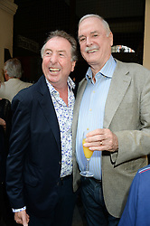 Left to right, ERIC IDLE and JOHN CLEESE at a private view of John Cleese - The Californian Collection at the Chris Beetles Gallery, Ryder Street, Mayfair, London, on 3rd September 2013.