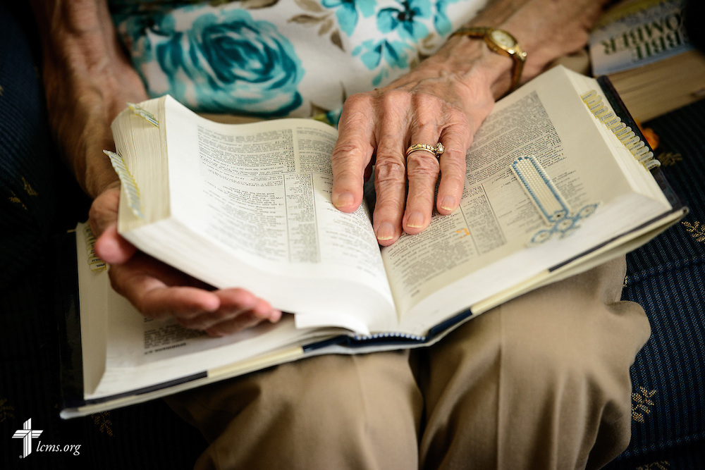 Lois Bengtson reads from her Bible during a home visitation with the Rev. Wally Arp of St. Luke's Lutheran Church on Monday, March 7, 2016, in Oviedo, Fla. LCMS Communications/Erik M. Lunsford