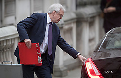 © Licensed to London News Pictures. 06/12/2017. London, UK. Brexit Secretary David Davis leaves his office in Downing Street to appear before the House of Commons Brexit Committee. Photo credit: Peter Macdiarmid/LNP