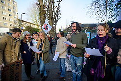 © Licensed to London News Pictures. 22/12/2016. London, UK. A group of campaigners sing Christmas carols outside Ealing Magistrates Court in London, where 15 protestors are charged with Wilful Obstruction of the Highway after blocking an access road to Heathrow on November 18, 2016. Photo credit: Ben Cawthra/LNP